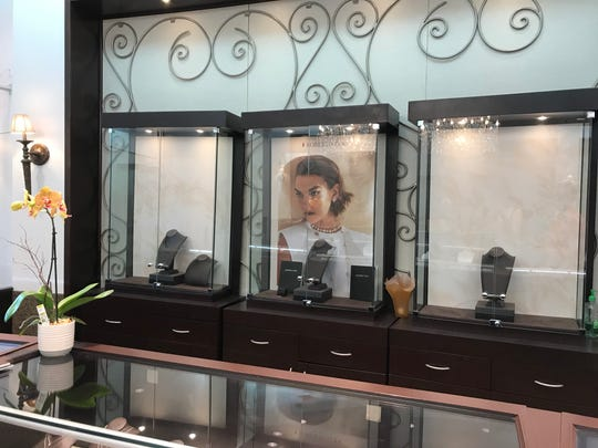 An emptied and broken display case at Provident Jewelry after burglars broke into the store.
