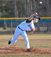 Hayden Honish of Oconto fires in a pitch in the April 16 game with Sevastopol.