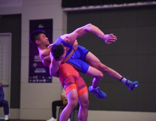 Guam's Lynch Xavier Tanglao Santos attempts to throw Palau's Cristian Etpison Nicolescu during the United World Wrestling Oceania Championships Yona 2019 at LeoPalace Resort Guam in Yona, April 20, 2019.