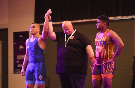 Guam's Michael Paul Shinohara gets a victory over Palau's Skarlee Uelas Renguul during the United World Wrestling Oceania Championships Yona 2019 at LeoPalace Resort Guam in Yona, April 20, 2019.