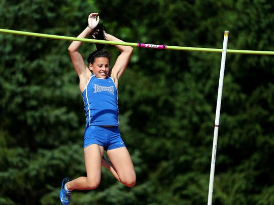 """Hamilton Southeastern's Kennedy Drish smiles as she clears 12'00"""" to win the Girls Pole Vault during the girls IHSAA State Finals at Indiana University's Robert C. Haugh Track & Field Complex in Bloomington, Saturday, June 3, 2017."""