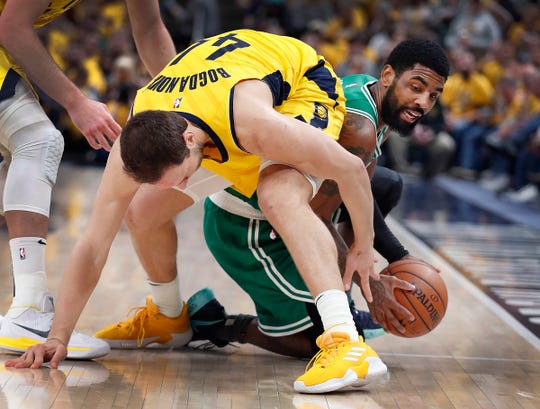 Boston Celtics guard Kyrie Irving (11) steals a loose ball from Indiana Pacers forward Bojan Bogdanovic (44) in the second half of their game at Bankers Life Fieldhouse on Friday, April 19, 2019. The Pacers lost to the Celtics 104-96.