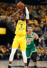 Indiana Pacers guard Darren Collison (2) shoots around Boston Celtics forward Jayson Tatum (0) in the first half of their game at Bankers Life Fieldhouse on Friday, April 19, 2019.