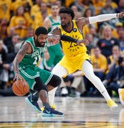 Wesley Matthews, then of the Pacers, defends Celtics guard Kyrie Irving in a game in April.