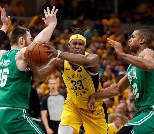 Indiana Pacers center Myles Turner (33) drives by Boston Celtics center Aron Baynes (46) in the first half of their game at Bankers Life Fieldhouse on Friday, April 19, 2019.