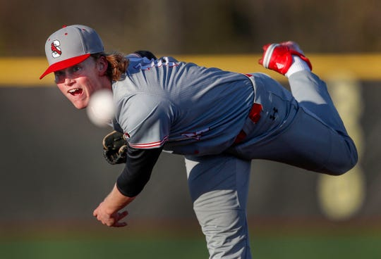 Southport High School pitcher Avery Short delivers a pitch to a Moeller (OH) High School batter during their game at Grand Park in Westfield on Friday, April 12, 2019.