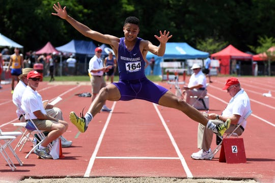 Brownsburg's Pierce Thomas competes in the long jump during the boys IHSAA track and field state finals at Robert C. Haugh Track and Field complex in Bloomington, Ind. on Saturday, May, 2, 2018.