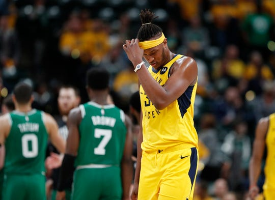 A dejected Indiana Pacers center Myles Turner (33) in the second half of their game Friday at Bankers Life Fieldhouse agaisnt the Celtics.