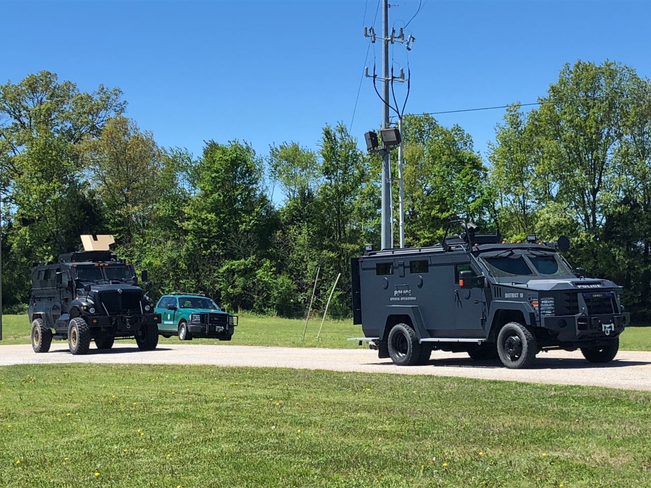 Armored vehicles leave Friendship Elementary School with other law enforcement officials in response to an allegedly armed suspect barricaded in a Friendship residence Saturday at around 12:45 p.m.