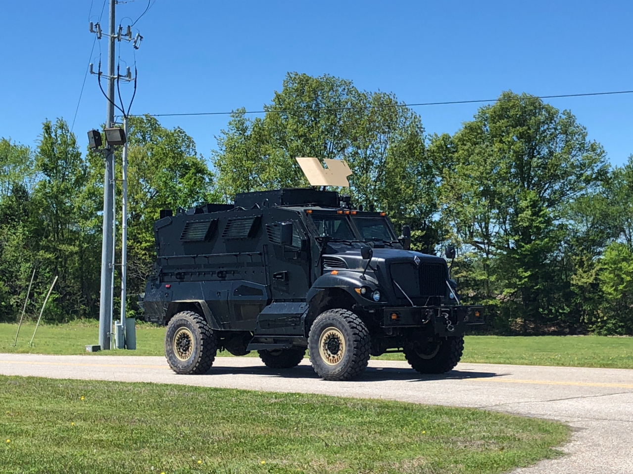 An armored vehicle prepares to move closer to the scene of an allegedly armed suspect barricaded in a Friendship residence Saturday at around 12:45 p.m.