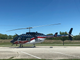 An Air Evac Lifeteam helicopter is posted at Friendship Elementary School in response to a potentially armed suspect who has been barricaded in a Mill Street residence since 10 a.m. Saturday.