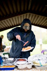 Joey Esslinger makes a plate of food during an Easter lunch for the homeless at Sam A. Duff Park in South Knoxville in Tennessee on Saturday, April 20, 2019. The lunch was organized by Next Step Initiative which provides contextualized life rehabilitation pathways for the homeless and those addicted to drugs.