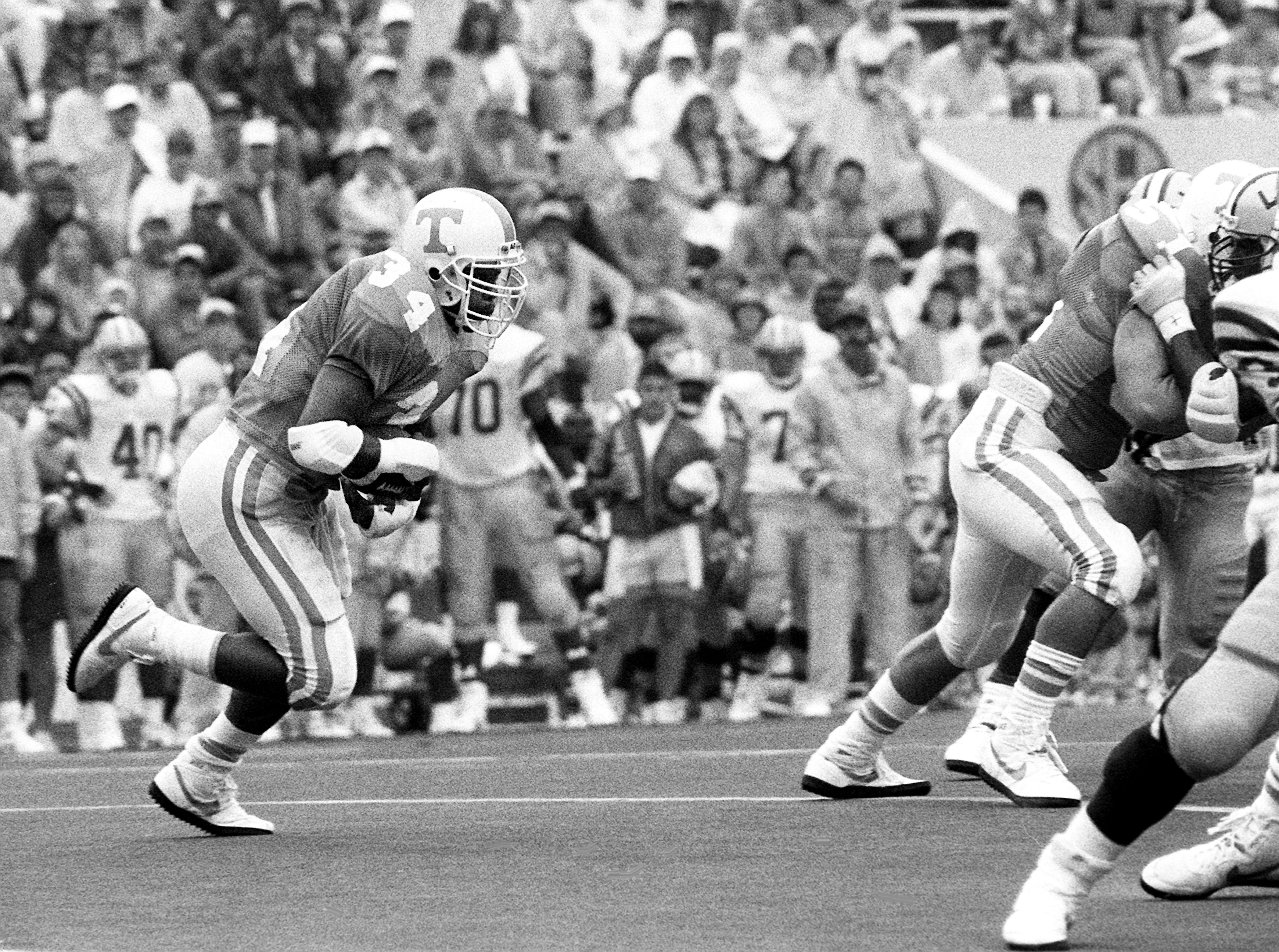 Tennessee junior back Reggie Cobb (34) picks up some of his 52 yards on 16 carries against LSU in the game. Winless Tennessee fall 34-9 to ninth-ranked LSU before 92,849 fans at Neyland Stadium in Knoxville.