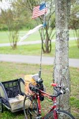 The bicycle of Bill Carpenter rests against a tree during an Easter lunch for the homeless at Sam A. Duff Park in South Knoxville in Tennessee on Saturday, April 20, 2019. The lunch was organized by Next Step Initiative which provides contextualized life rehabilitation pathways for the homeless and those addicted to drugs.