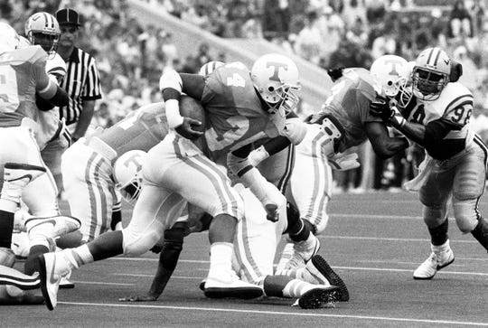 Tennessee junior back Reggie Cobb (34) looks for an opening against LSU. Cobb rush for 52 yards on 16 carries in the game. Winless Tennessee fall 34-9 to ninth-ranked LSU before 92,849 fans at Neyland Stadium in Knoxville. 9/17/1988