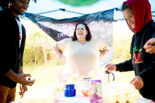 Addie Arbach dyes eggs with attendees during an Easter lunch for the homeless at Sam A. Duff Park in South Knoxville in Tennessee on Saturday, April 20, 2019. The lunch was organized by Next Step Initiative which provides contextualized life rehabilitation pathways for the homeless and those addicted to drugs.