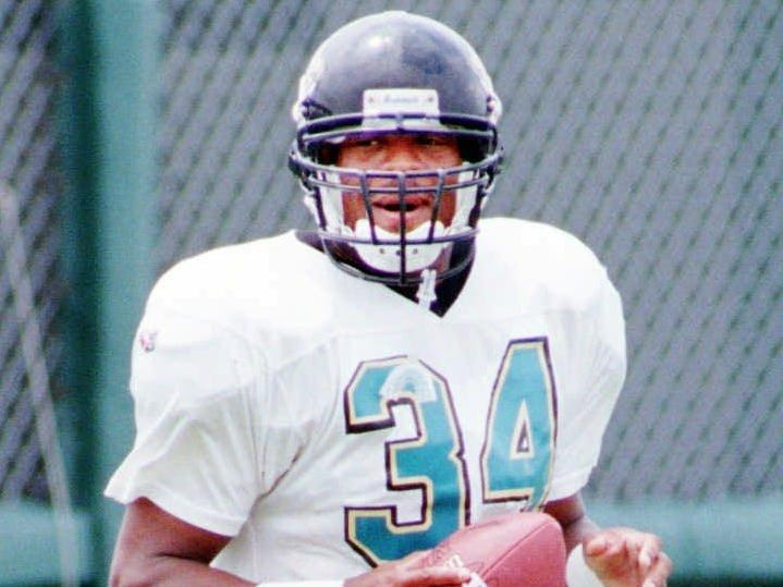Jacksonville Jaguars running back Reggie Cobb(34) returned to practice Monday afternoon August 21, 1995 in Jacksonville, Fla. Cobb suffered an injury to his right knee during the third play of the game in Jacksonville's preseason loss to the Carolina Panthers in the Hall of Fame game in Canton, Ohio on July 29, 1995.