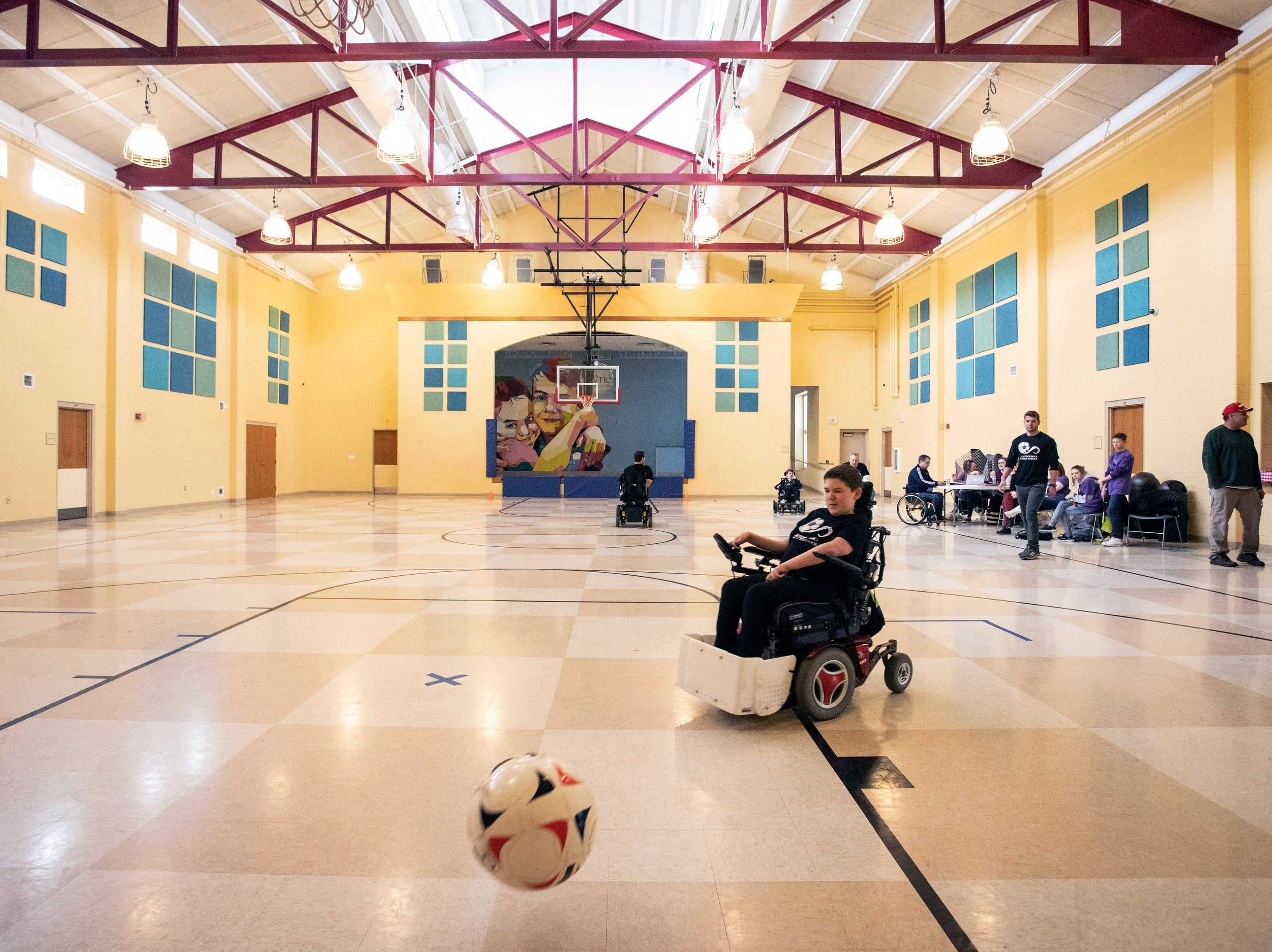 Connor deLuca takes shots at the goal during a Louisville City Power Soccer practice on Saturday afternoon. April 20, 2019