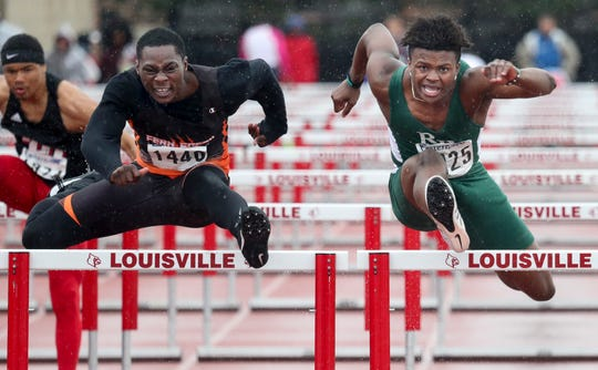 Rock Bridge High School's Martez Manuel edges out Fern Creek's Vasean Green to win his heat of the Boys 110 Meter Hurdles on April 20.
