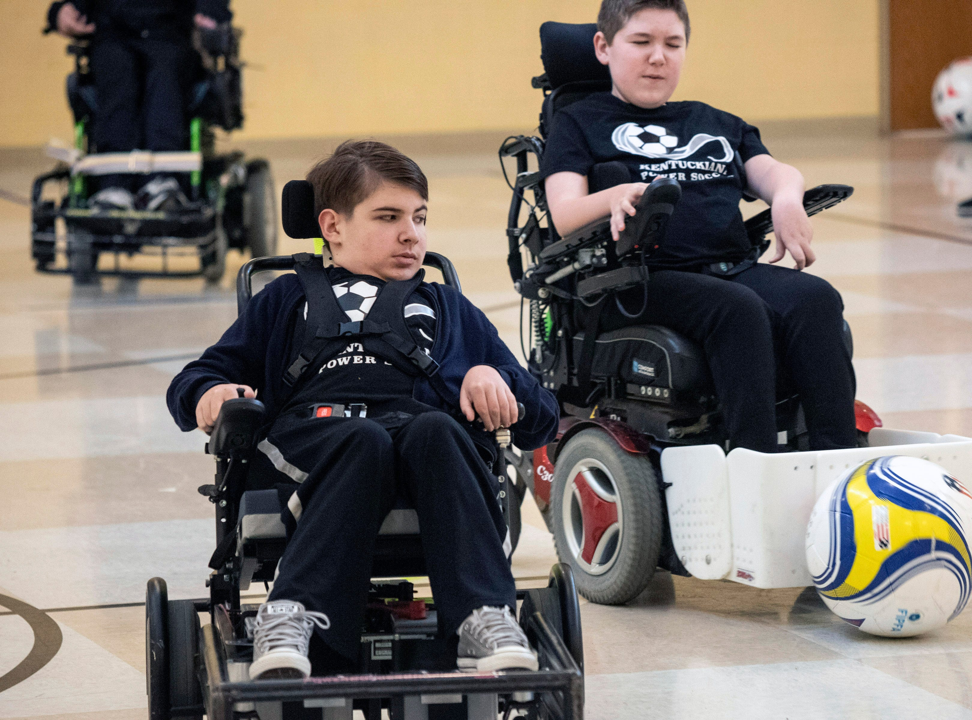 Cosmo Rudd keeps a close eye on teammate Connor deLuca and the ball during the Louisville City Power Soccer practice on Saturday. April 20, 2019
