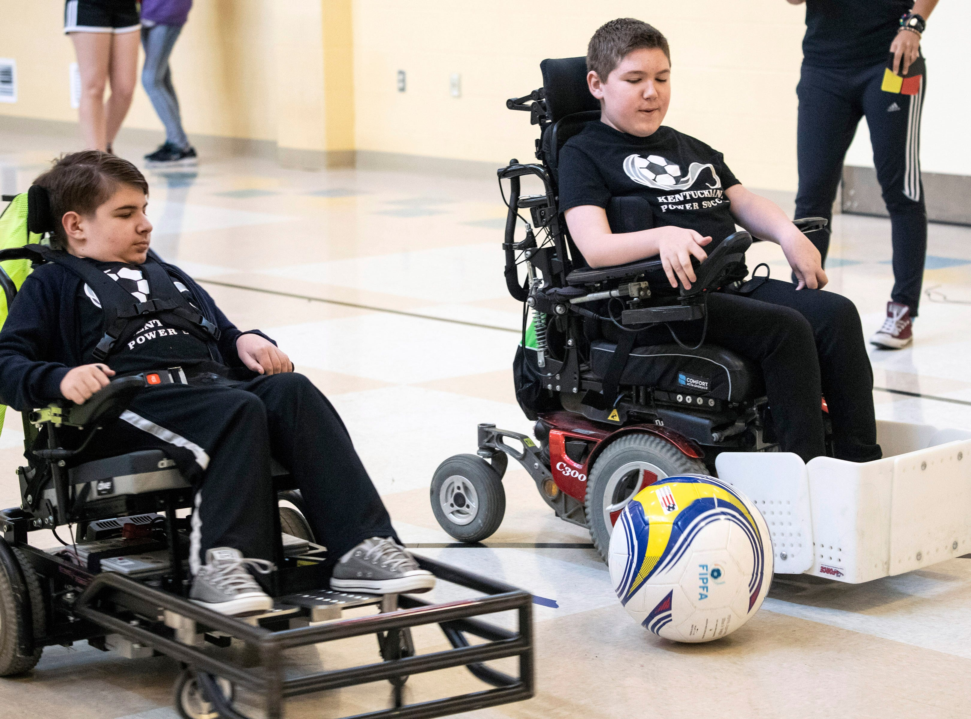 Cosmo Rudd works on moves with teammate Connor deLuca during a Louisville City Power Soccer practice on Saturday. April 20, 2019