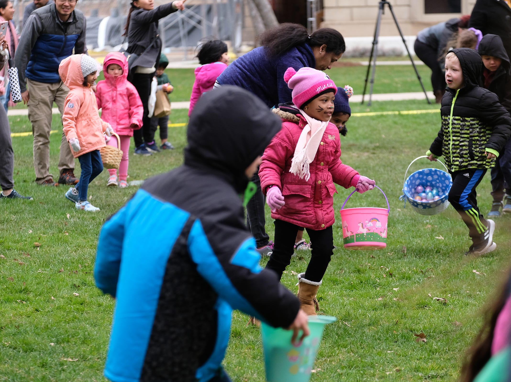 The scramble is on at the annual Lansing Jaycees Easter Egg Hunt at the Capitol Saturday, April 20, 2019.