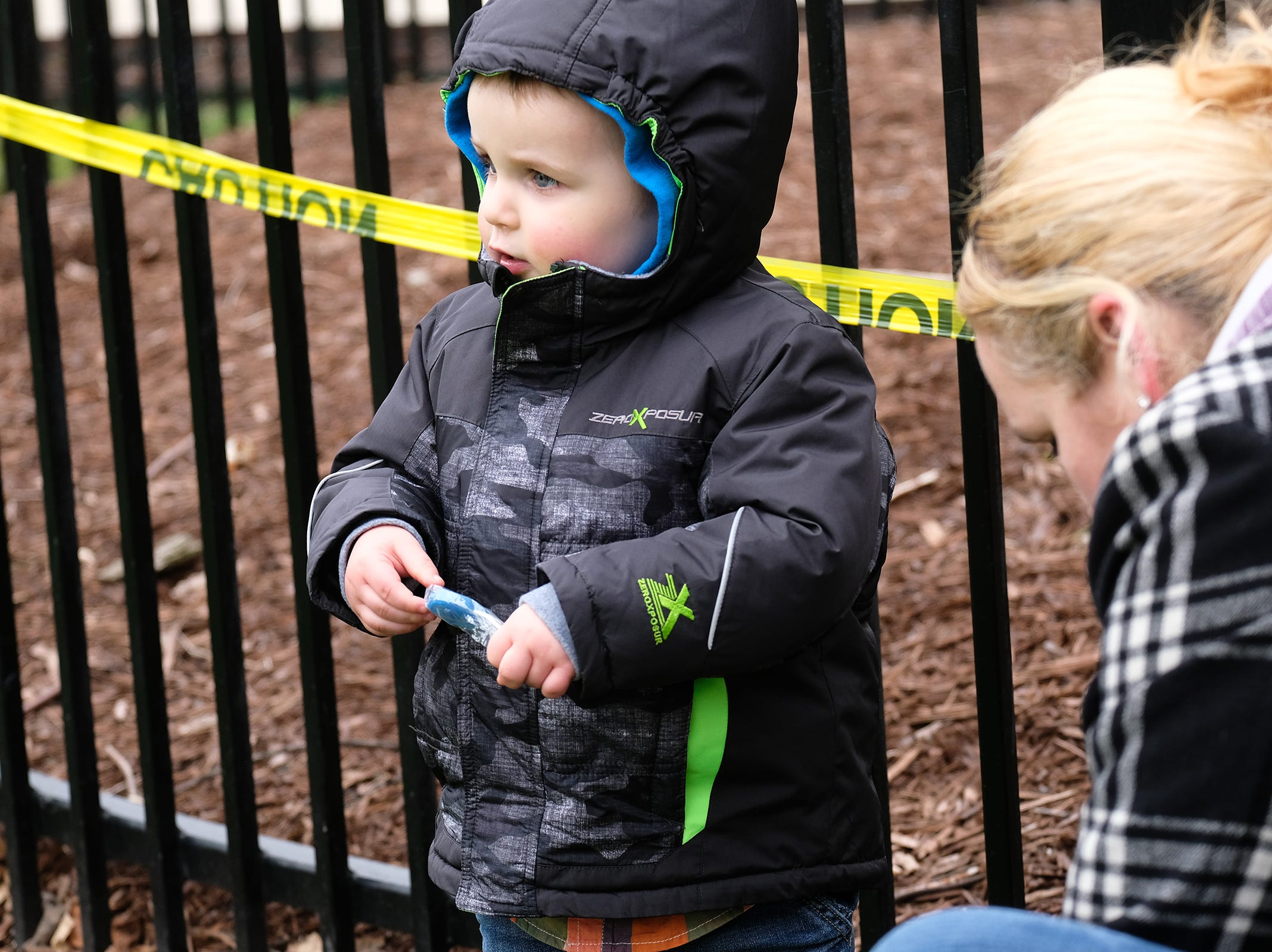 This youngster opens up one of several Easter eggs he collected at the annual Lansing Jaycees Easter Egg Hunt at the Capitol Saturday, April 20, 2019.