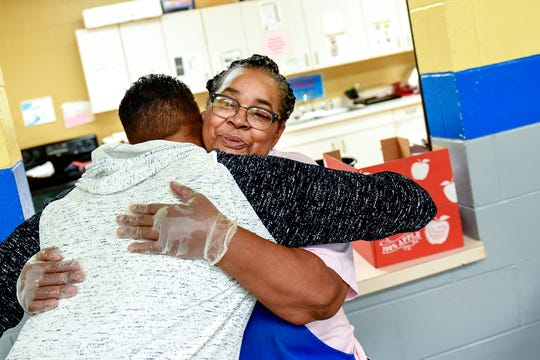 "Robert Ray Jr., left, hugs lunch supervisor Ms. Willie ""Granny"" Dawson during a visit on Wednesday, April 17, 2019, at the Boys & Girls Club of Lansing."