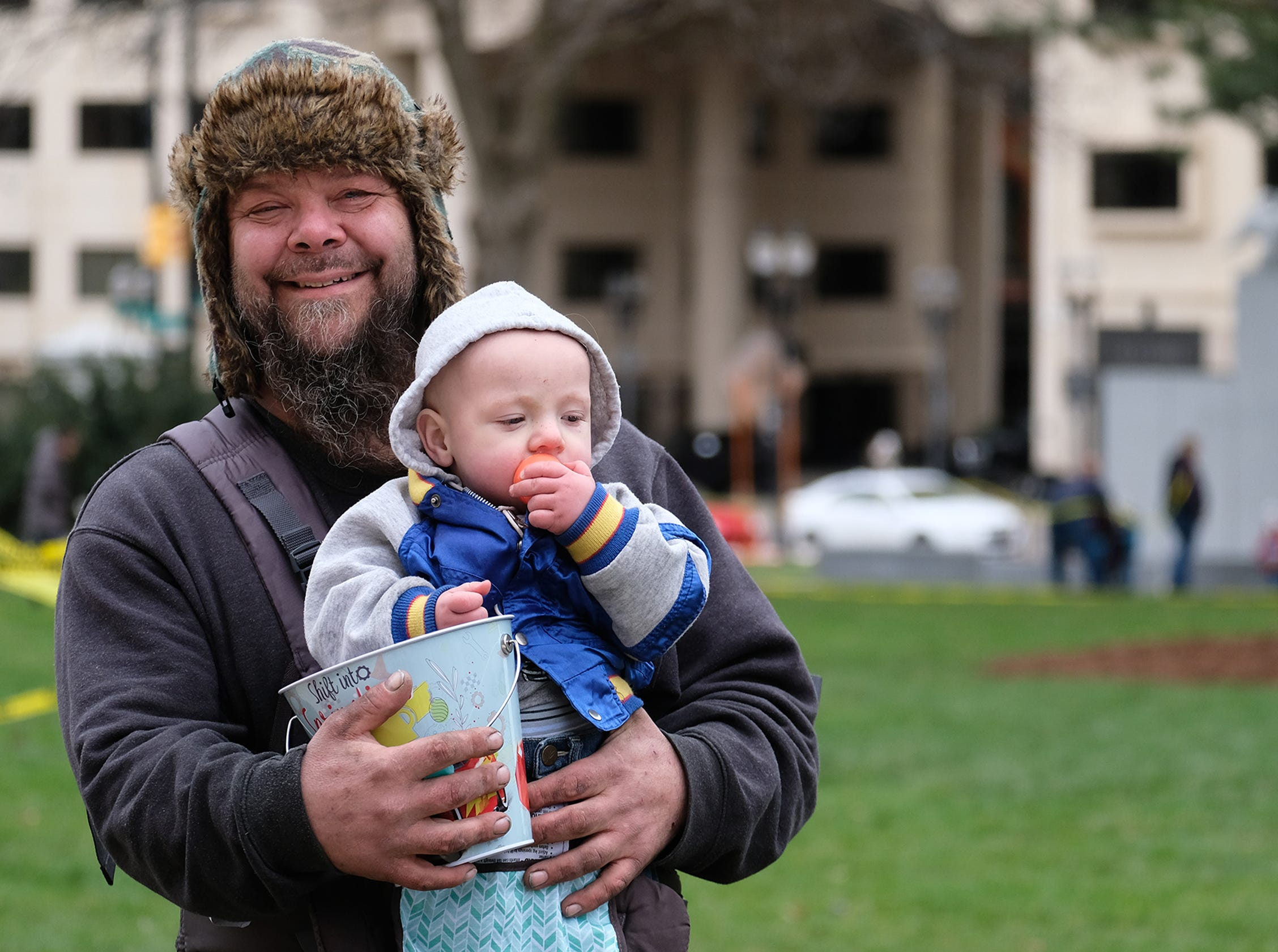 Steven Lull from Lansing and his son Atreyu, 1, have fun at the annual Lansing Jaycees Easter Egg Hunt at the Capitol Saturday, April 20, 2019.