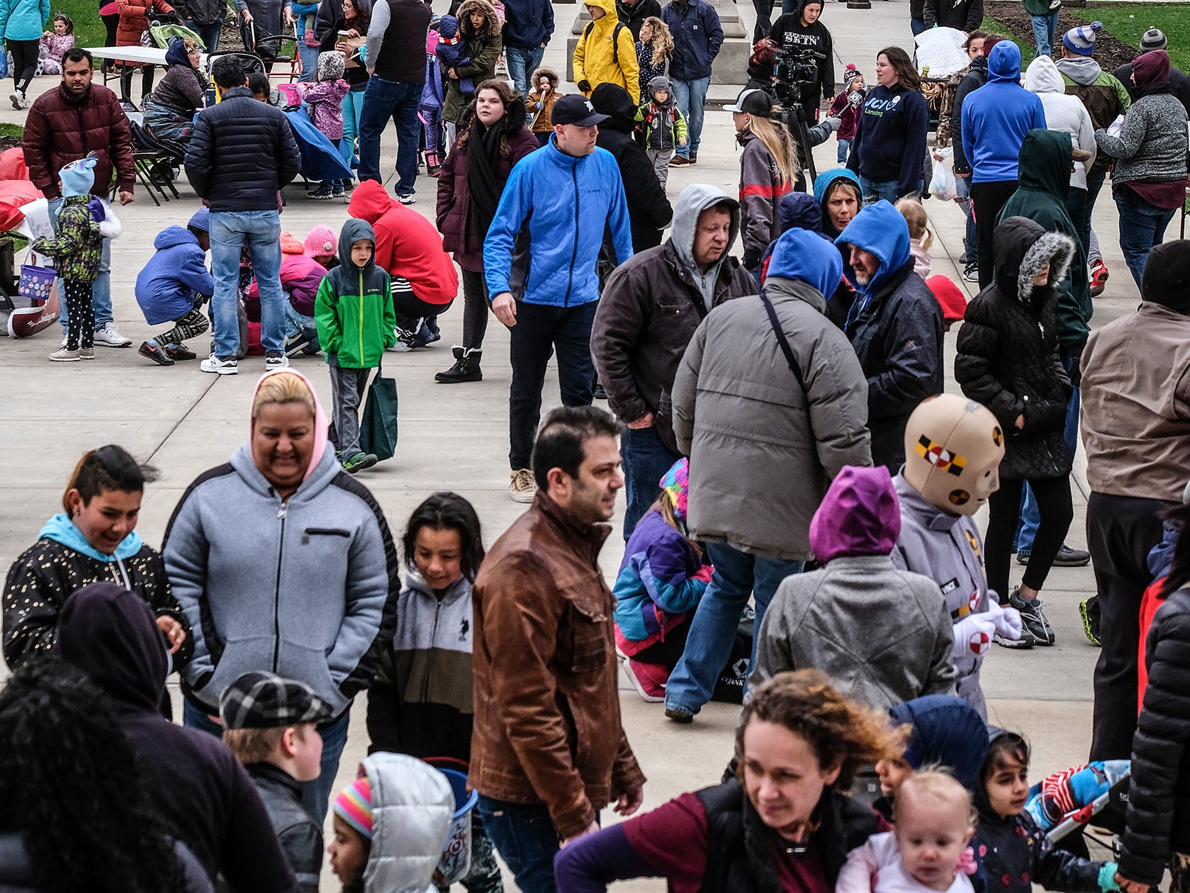 Families gather at the state Capitol for the annual Lansing Jaycees Easter Egg Hunt to begin another round Saturday, April 20, 2019.