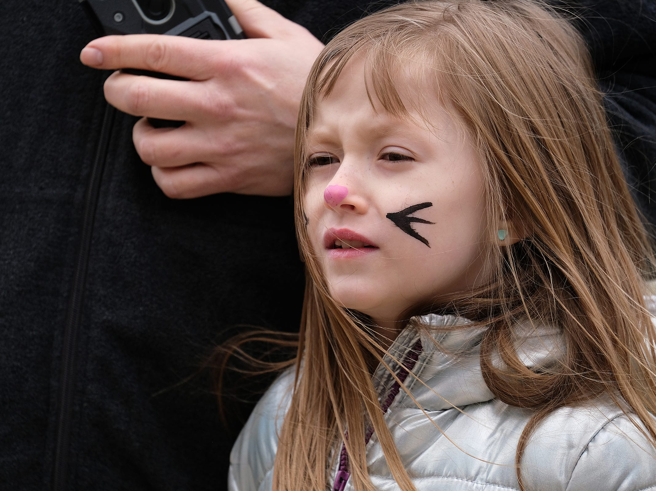 Sydney Sharp, 8, from Lansing, watches some line dancing going on at the annual Lansing Jaycees Easter Egg Hunt at the Capitol Saturday, April 20, 2019.