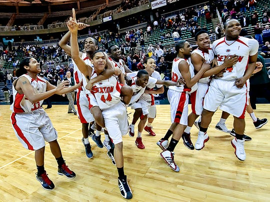 Members of the Sexton Boys basketball team, including Robert Ray Jr. at far left, celebrate their Class B Boys State Championship win over Muskegon Heights on Saturday March 26, 2011, at the Breslin Center in East Lansing.