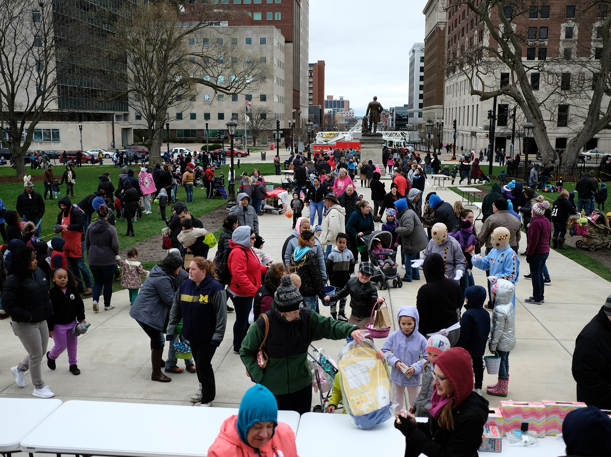 Families gather at the annual Lansing Jaycees Easter Egg Hunt at the Capitol Saturday, April 20, 2019.