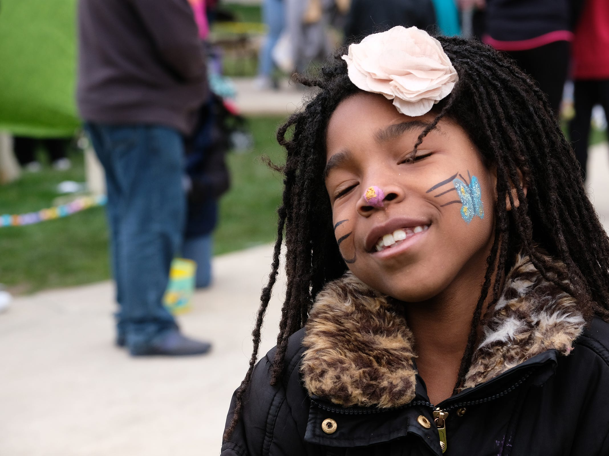 Mary Wilson, 7, from Lansing shows off her painted face at the annual Lansing Jaycees Easter Egg Hunt at the Capitol Saturday, April 20, 2019.