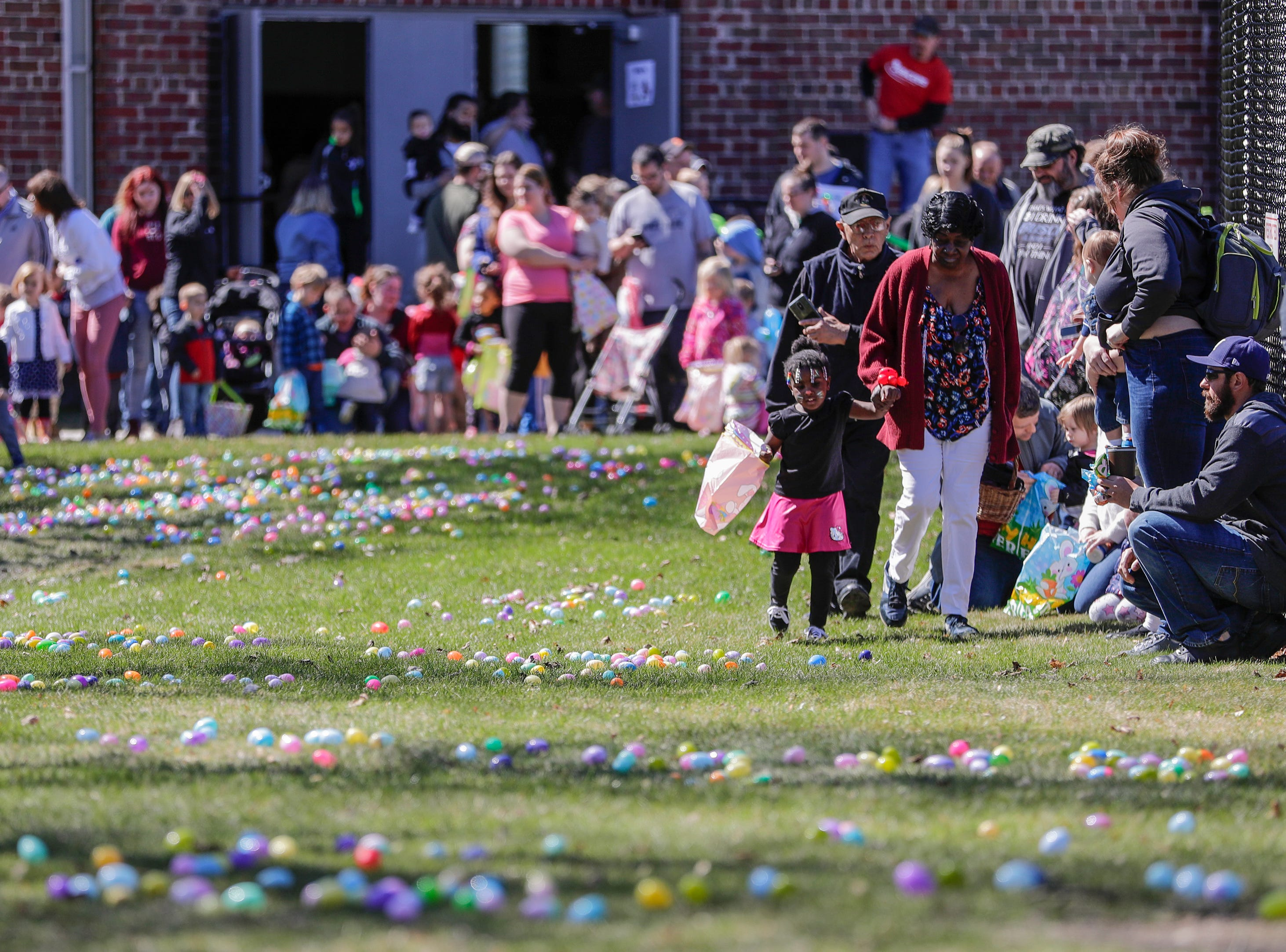 Kids and parents gather around the perimeter of the Easter egg hunt during the Easter Eggstravaganza at Citizen Park Saturday, April 20, 2019, in Manitowoc, Wis. Joshua Clark/USA TODAY NETWORK-Wisconsin
