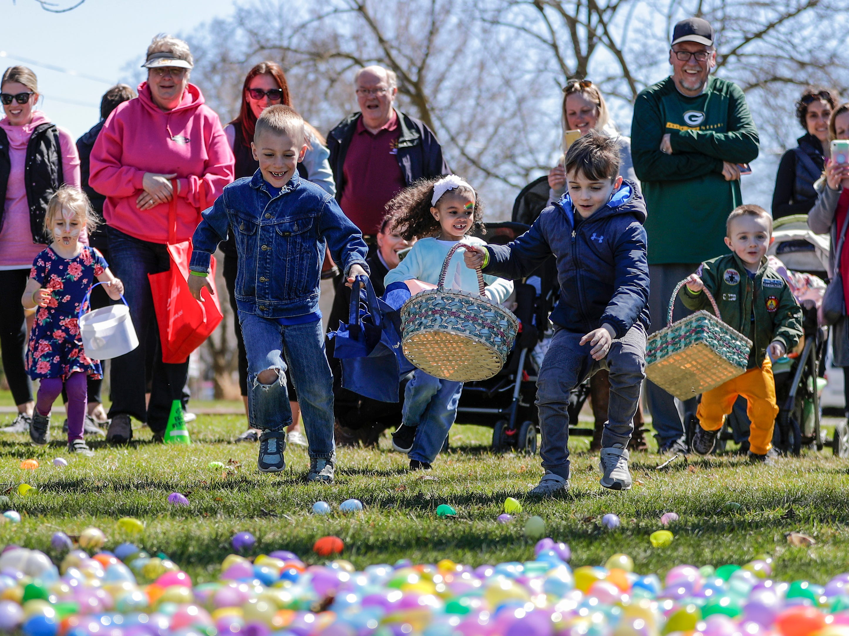 Children rush to plastic Easter eggs at the start of an Easter egg hunt during the Easter Eggstravaganza at Citizen Park Saturday, April 20, 2019, in Manitowoc, Wis. Joshua Clark/USA TODAY NETWORK-Wisconsin