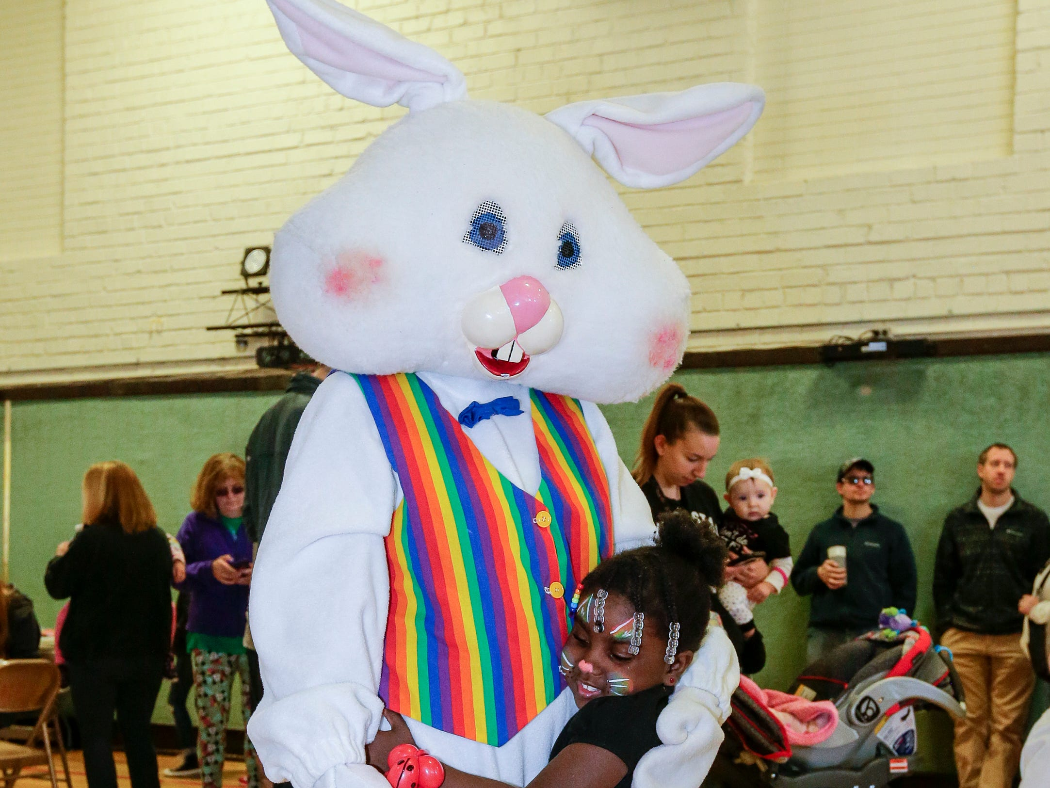 DeRosalind Spencer, 4, hugs the Easter bunny during the Easter Eggstravaganza at Citizen Park Saturday, April 20, 2019, in Manitowoc, Wis. Joshua Clark/USA TODAY NETWORK-Wisconsin