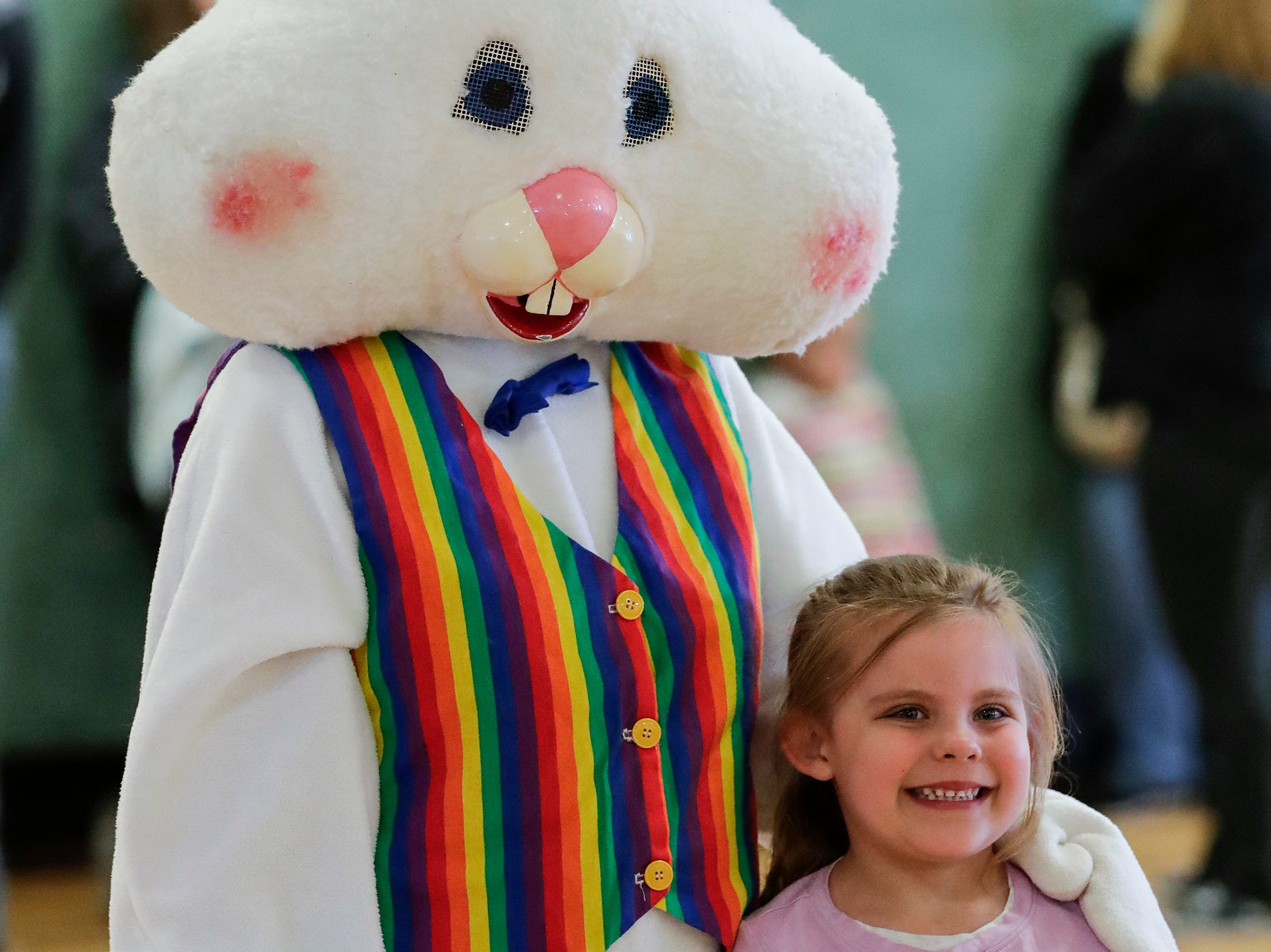 Sophie Wanta poses with the Easter bunny during the Easter Eggstravaganza at Citizen Park Saturday, April 20, 2019, in Manitowoc, Wis. Joshua Clark/USA TODAY NETWORK-Wisconsin