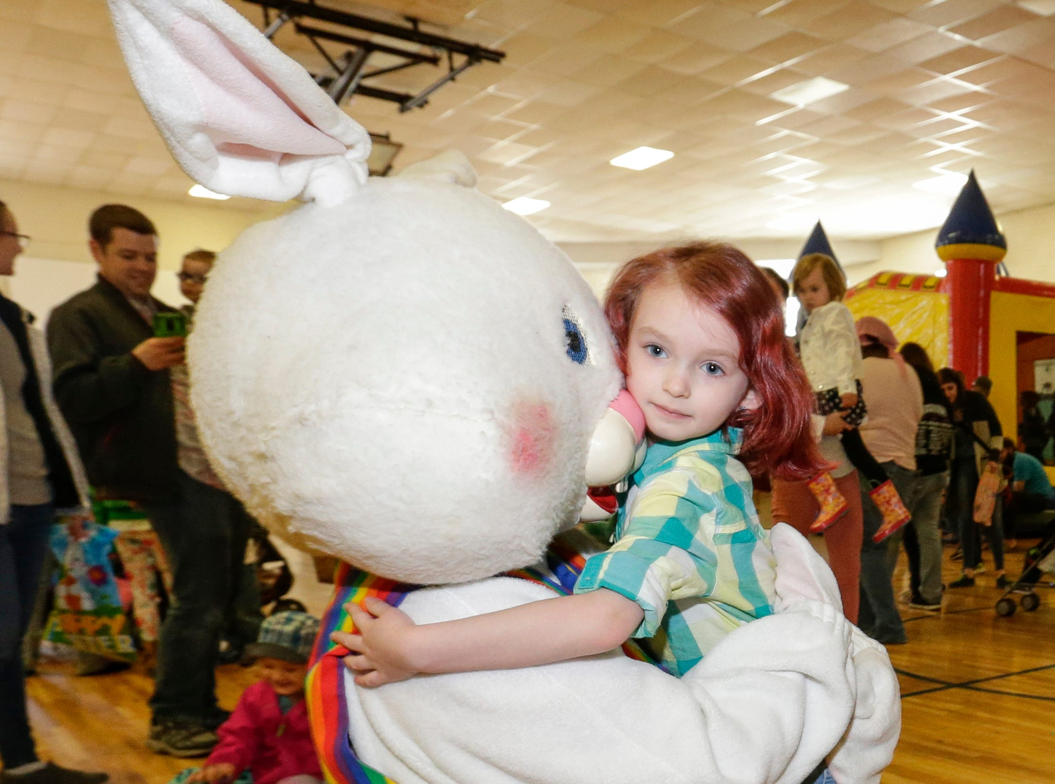Jillian Krause, 5, hugs the Easter bunny during the Easter Eggstravaganza at Citizen Park Saturday, April 20, 2019, in Manitowoc, Wis. Joshua Clark/USA TODAY NETWORK-Wisconsin