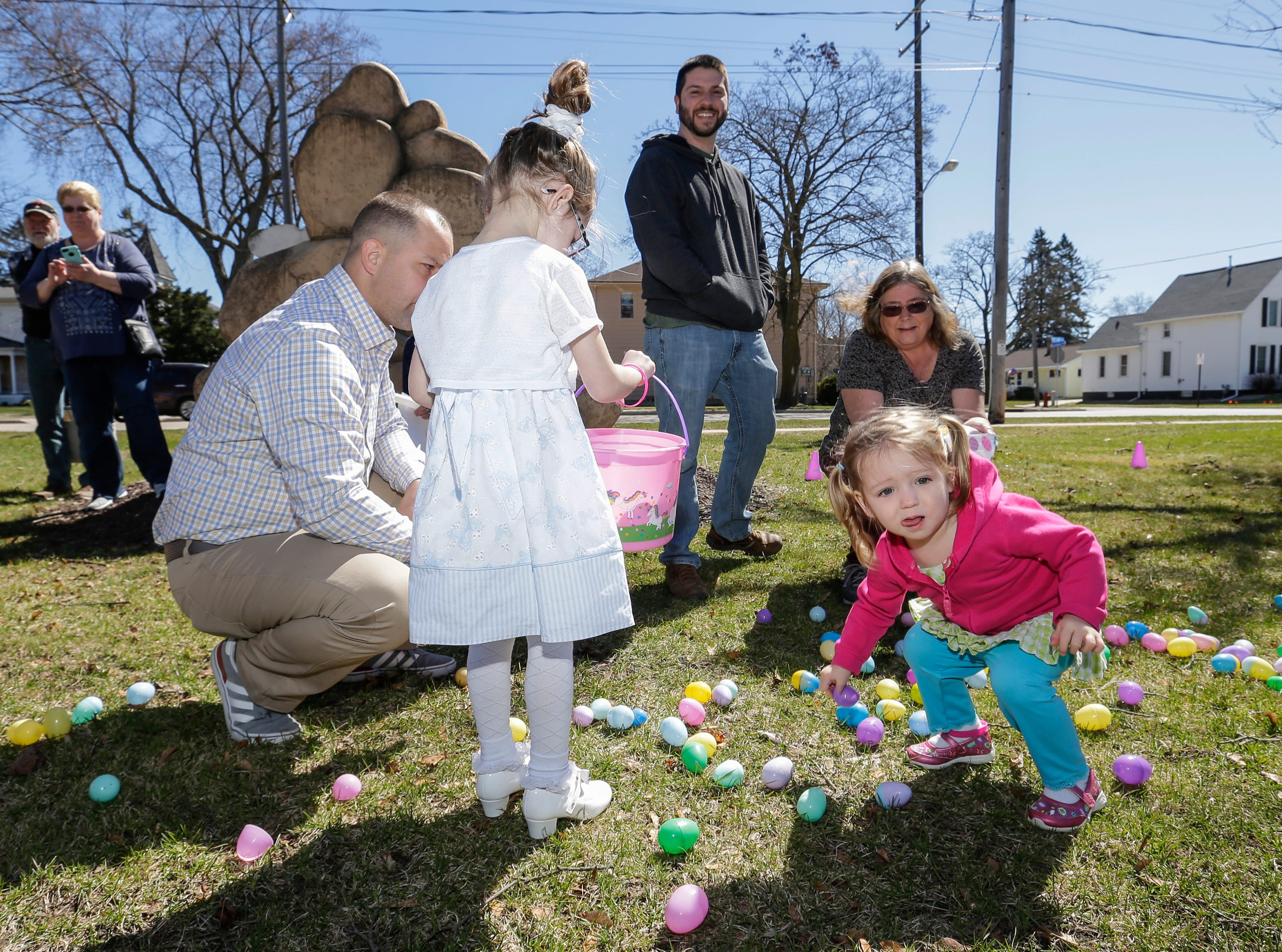 Children gather plastic Easter eggs during the Easter Eggstravaganza at Citizen Park Saturday, April 20, 2019, in Manitowoc, Wis. Joshua Clark/USA TODAY NETWORK-Wisconsin
