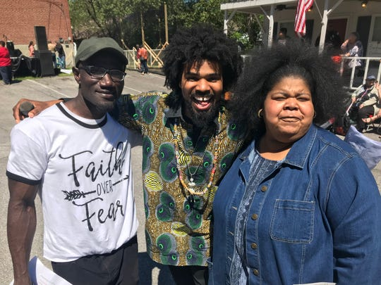 Binghampton International Festival co-hosts Johnny Doe, left, and Justin Merrick, middle, with Floridia Jackson