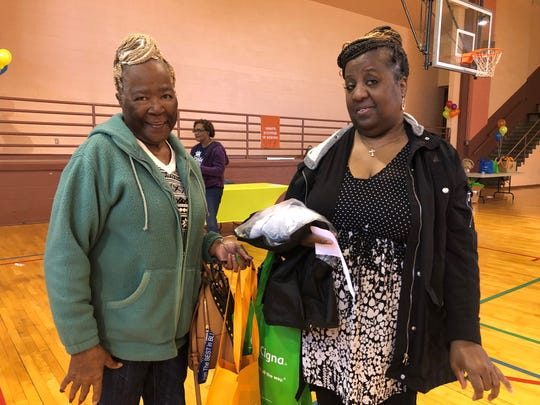 Neighbors Gladys Bowens and Joyce Dowell attend the Orange Mound Community Health Fair