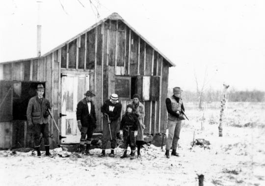 "Aldo Leopold, right, and members of his family prepare to go hunting in 1935 at the ""Shack"" near Baraboo, Wisconsin."