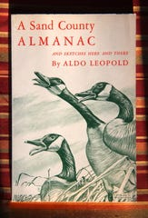 "An image shows the cover of ""A Sand County Almanac"" by Aldo Leopold. The book, published in 1949, is revered for its elegant prose and lessons of ecological consciousness."