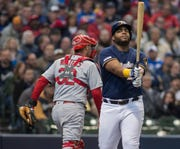 Milwaukee Brewers first baseman Jesus Aguilar, right, reacts after being called out against the St. Louis Cardinals during the second inning of a baseball game Wednesday, April 17, 2019, in Milwaukee. (AP Photo/Darren Hauck) ORG XMIT: WIDH106