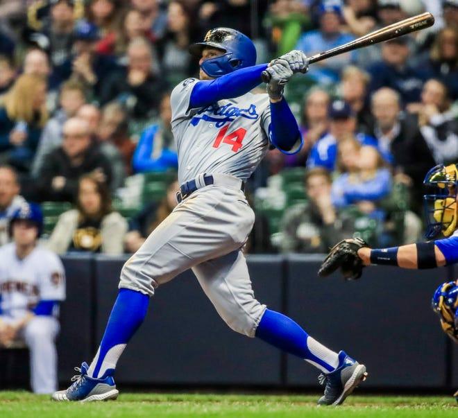 Dodgers second baseman Kike Hernandez launches a three-run homer Friday night.