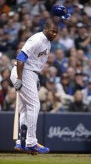 Brewers centerfielder Lorenzo Cain reacts after getting hit by a pitch during the seventh inning.