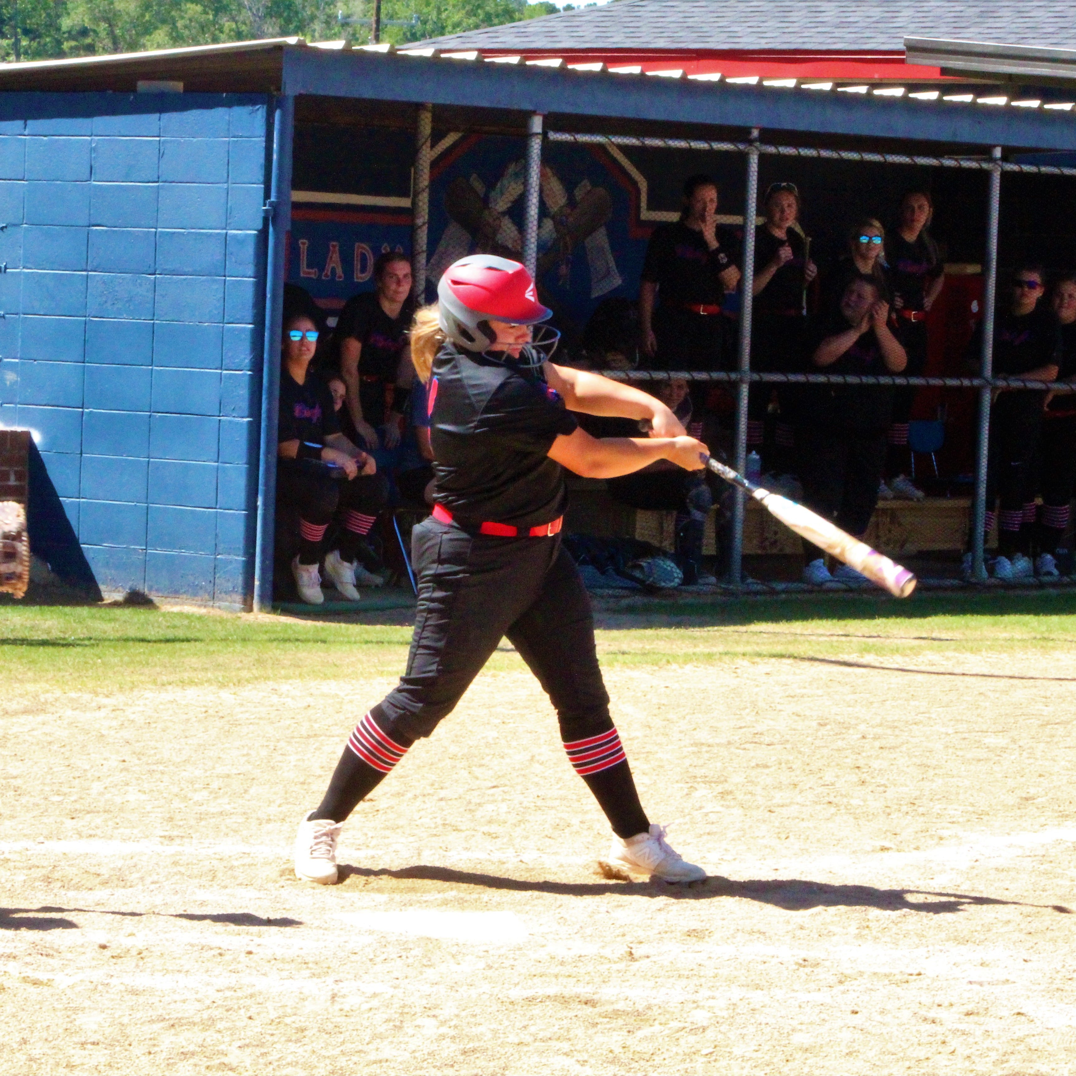 West Ouachita third baseman Joyce Currie (14) hits a solo homerun in the bottom of sixth inning to give the Lady Chiefs a 6-0 lead over the DeRidder Lady Dragons in the Class 4A quarterfinal playoffs at West Ouachita's Reservation on Saturday afternoon.