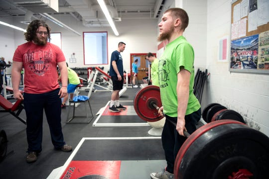 Devin Heymach practices as Patrick Narcise looks on during Lift it Up, a weightlifting program that pairs Challenger athletes with neurotypical buddies at Morris Hills High School on Saturday, April 20, 2019.