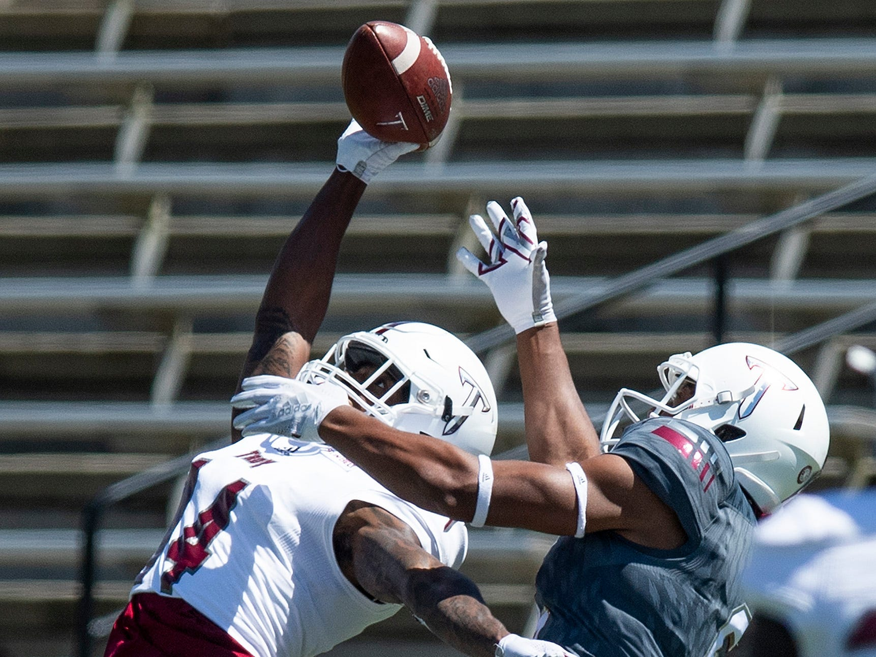 Troy cornerback Terence Dunlap (14) breaks up a pass intended for wide receiver Khalil McClain (6) during the Troy University T-Day spring scrimmage game in Troy, Ala., on Saturday April 20, 2019.